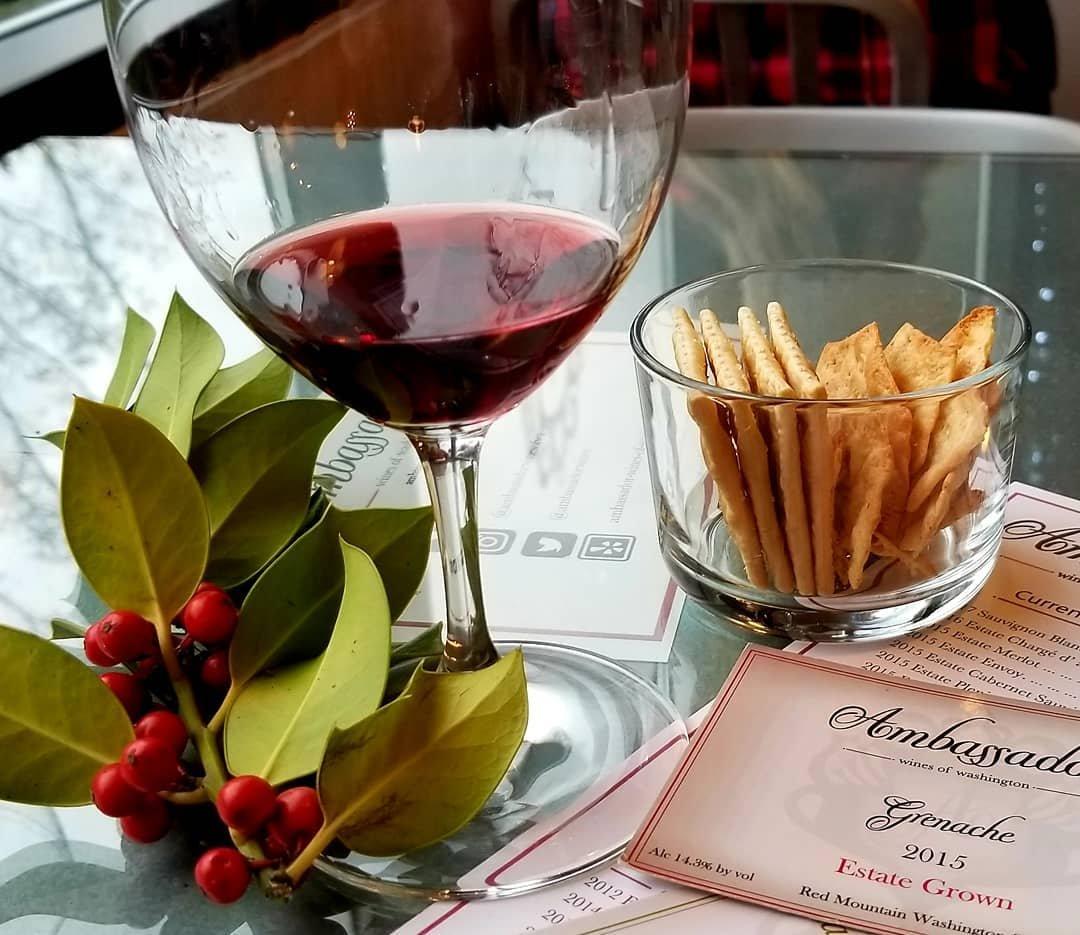 Glass of red wine and bowl of crakers at Ambassador Wines near Bothell, Washington.