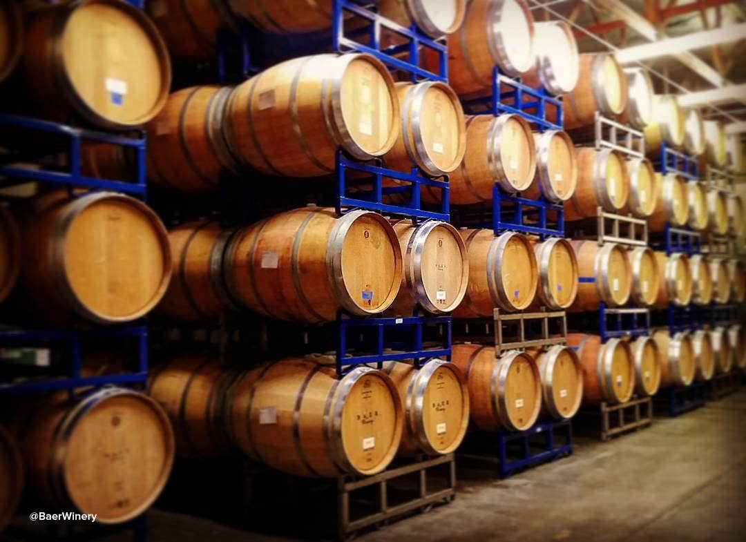 Wall full of wine barrels inside of Baer Winery near Bothell, Washington.