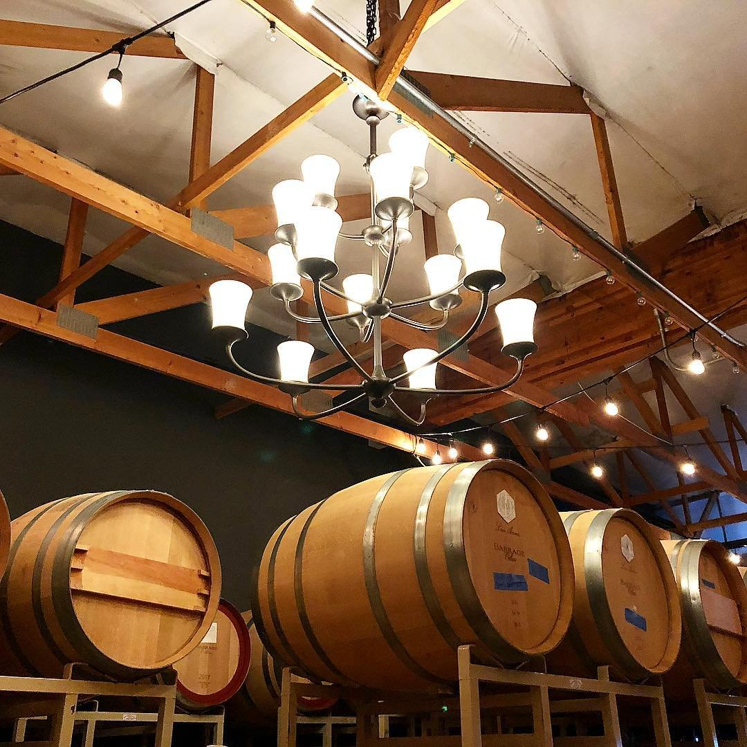 Wooden wine barrels inside of Barrage Cellars winery near Bothell, Washington.