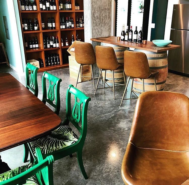 Tables and chairs inside of Belle and Bottle wine store in Bothell, Washington.