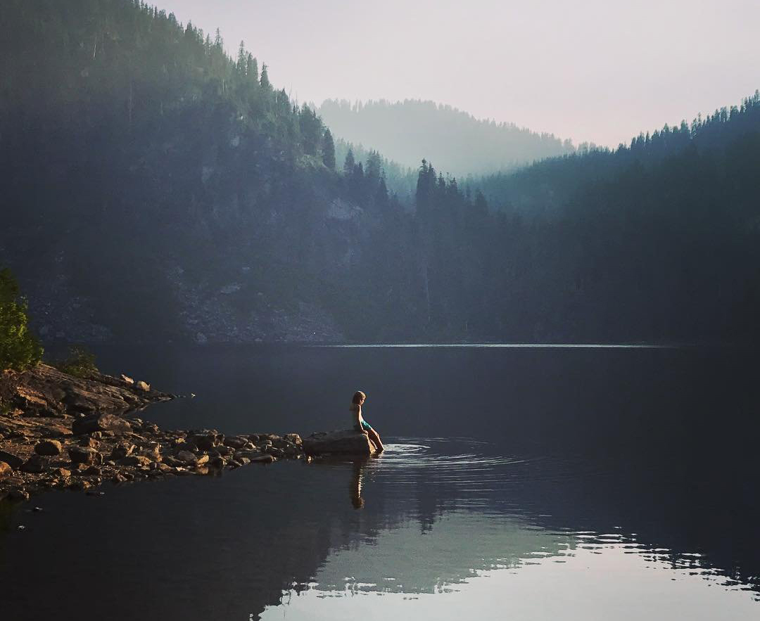 Person dipping their toes into the Boardman Lakes in Bothell, Washington.