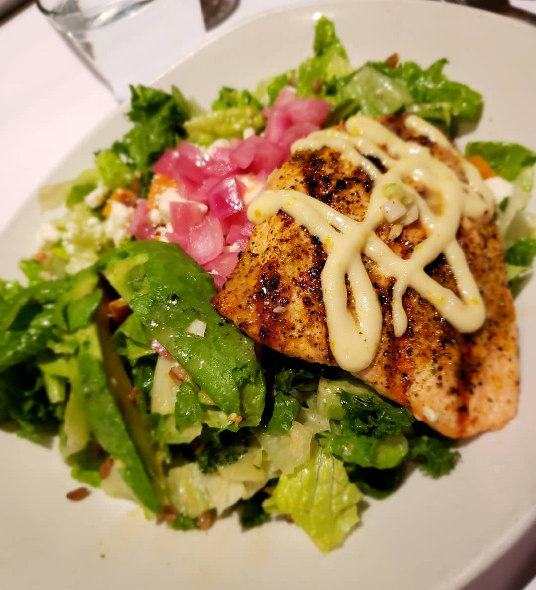 Salad entrée with fish on top from Bonefish Grill in Bothell, Washington.