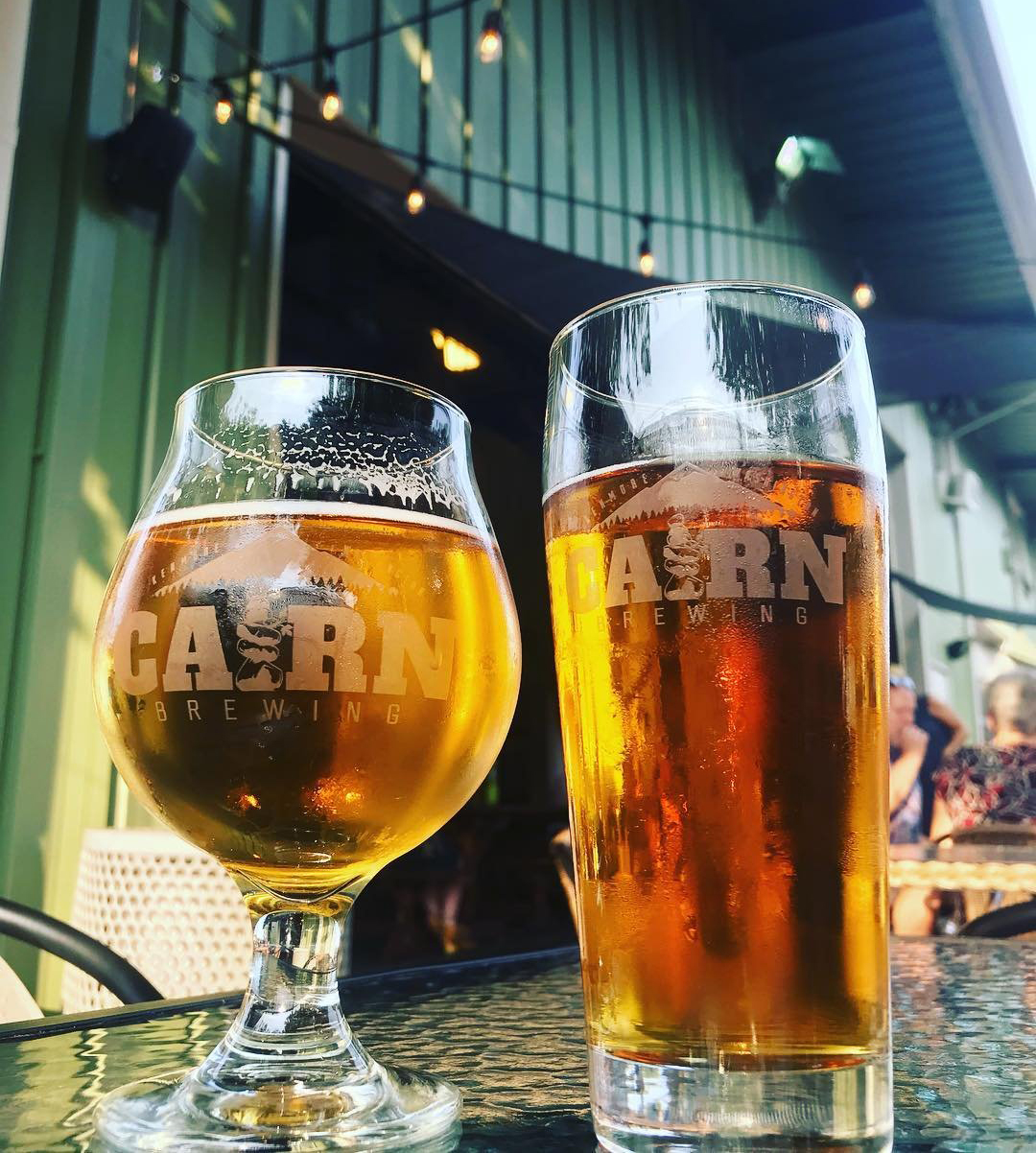 Glasses of beer on a table outside of Carin Brewing near Bothell, Washington.