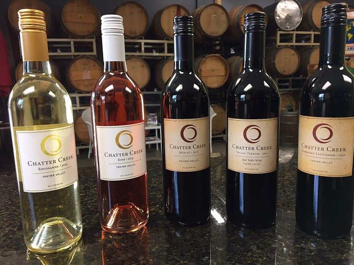 Different bottles of wine lined up at Chatter Creek Winery near Bothell, Washington.