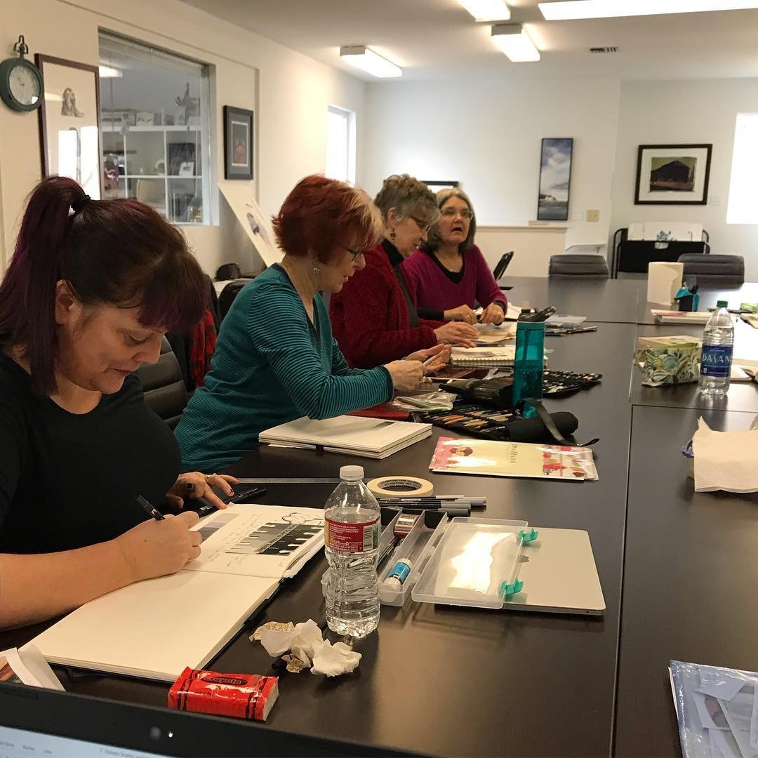 Women working on art projects at Cloud 9 Art School in Bothell, Washington.