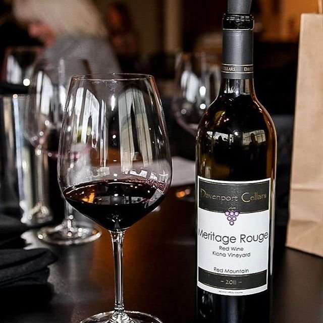 Bottle and glass of red wine from Davenport Cellars boutique winery near Bothell.
