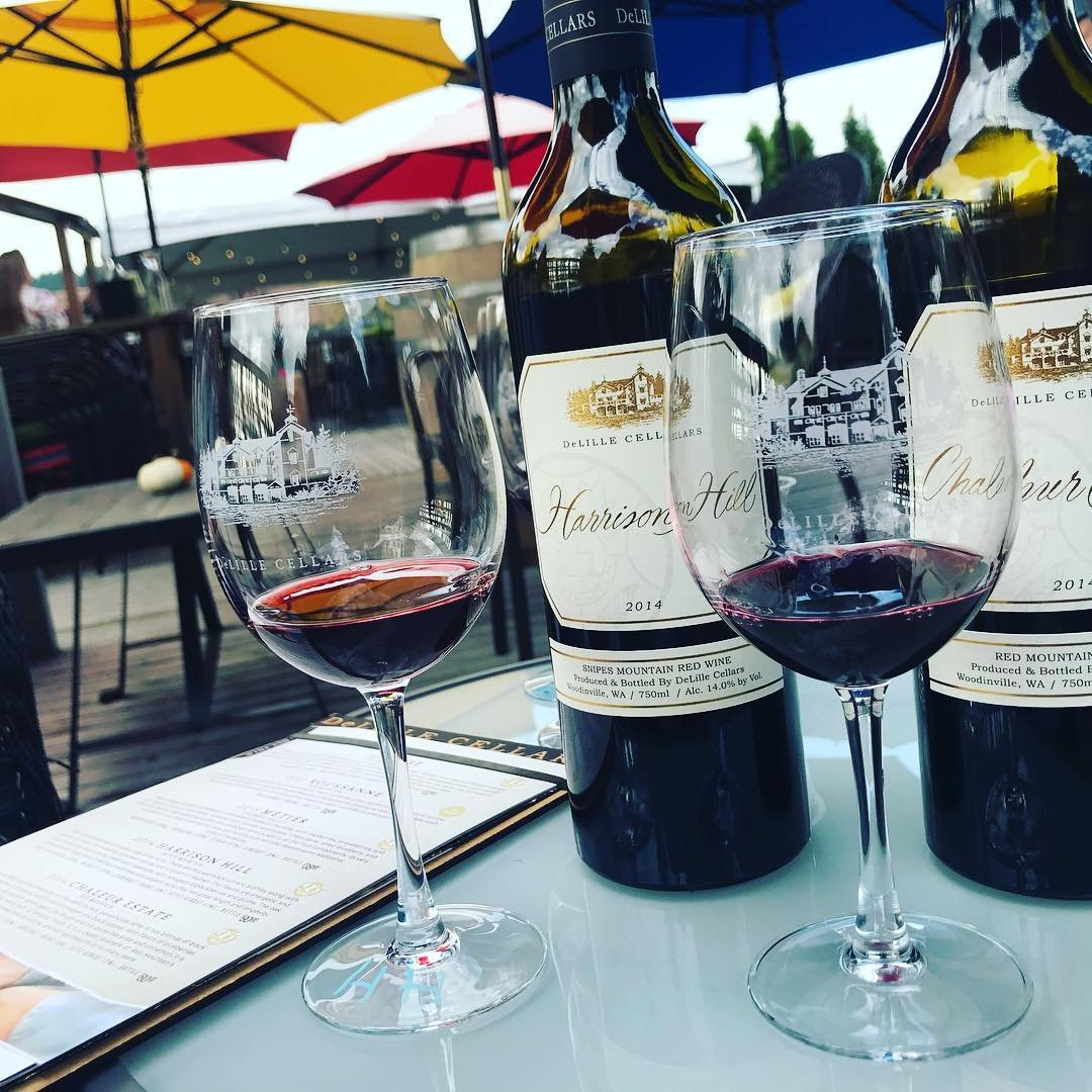 Two glasses of wine on a table outside of DeLille Cellars near Bothell, Washington.