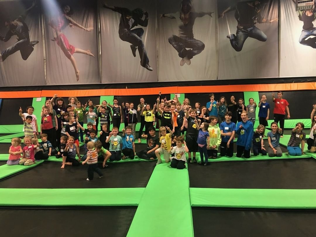 Kids posing for a photo at Elevated Sports Trampoline park in Bothell, Washington.
