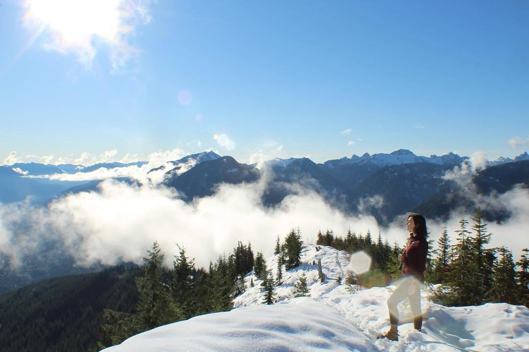 Woman at the top of the snowy Evergreen Mountain near Bothell, Washington.