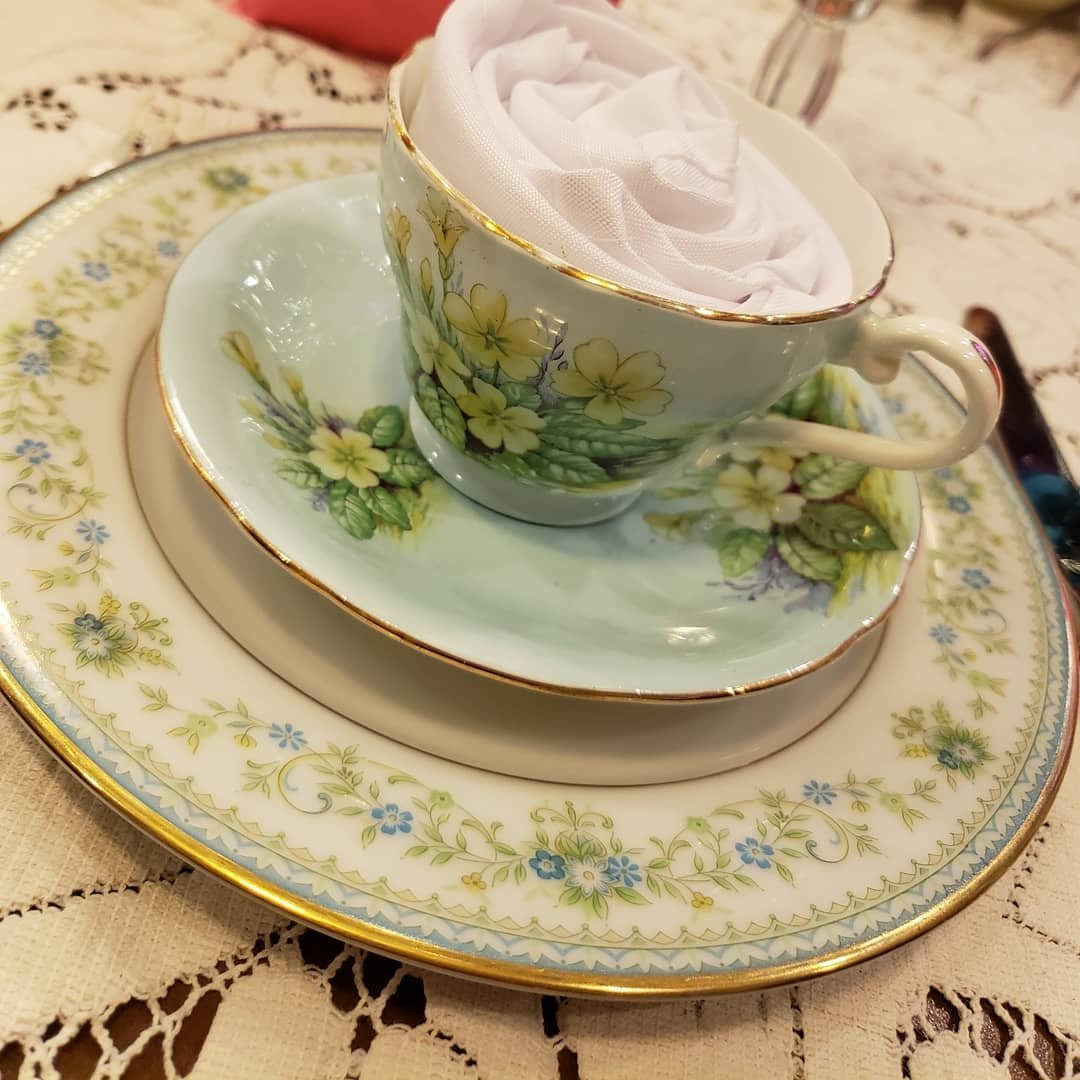 Floral tea cup with a napkin rose, at Graham's Royal Tea in Bothell, Washington.