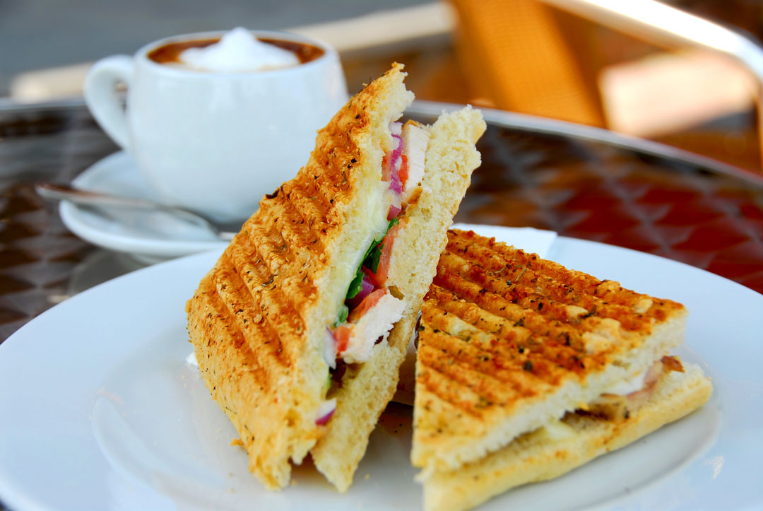 Panini sandwich and cup of coffee from Gretchen's Place in Bothell, Washington.