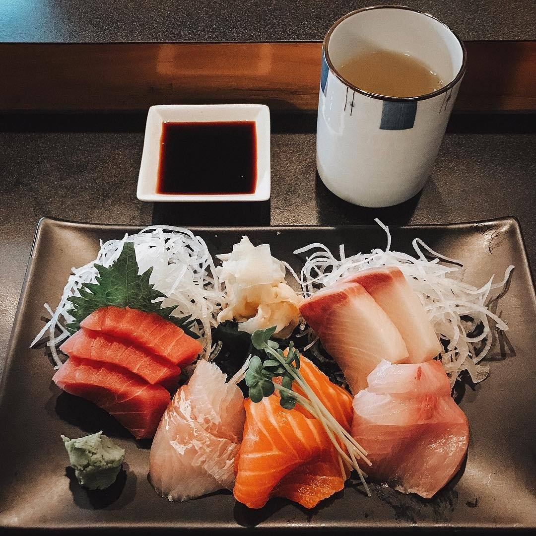 Plate of sushi, dish of soy sauce, and a cup of tea from Hana Sushi in Bothell.