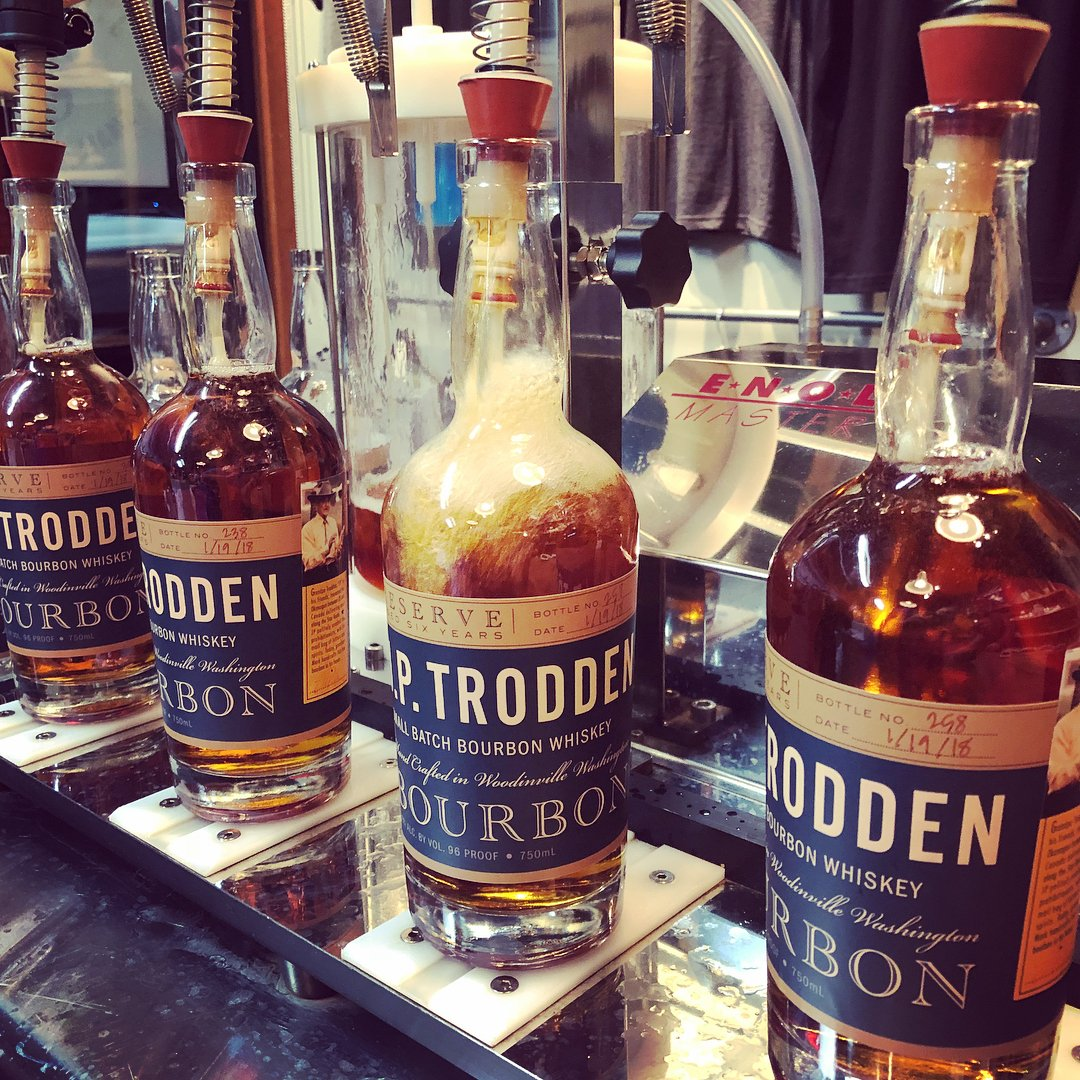 Bottles of bourbon being filled at JP Trodden Distillery near Bothell, Washington.