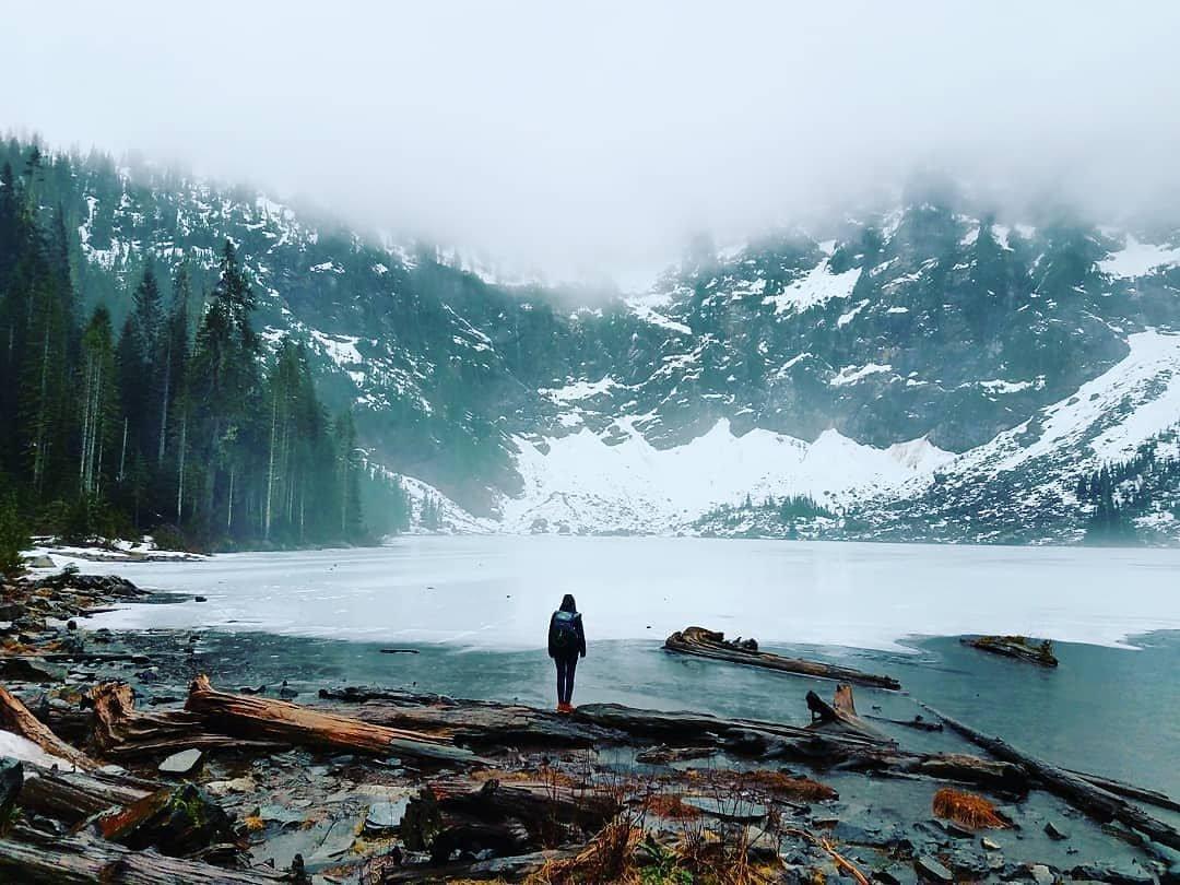 Person looking out on the snowy, frozen Lake TwentyTwo near Bothell, Washington.