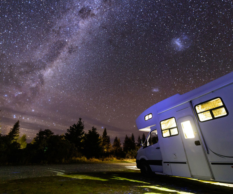 Camper parked under the stars at Lake Pleasant RV Park in Bothell, Washington.