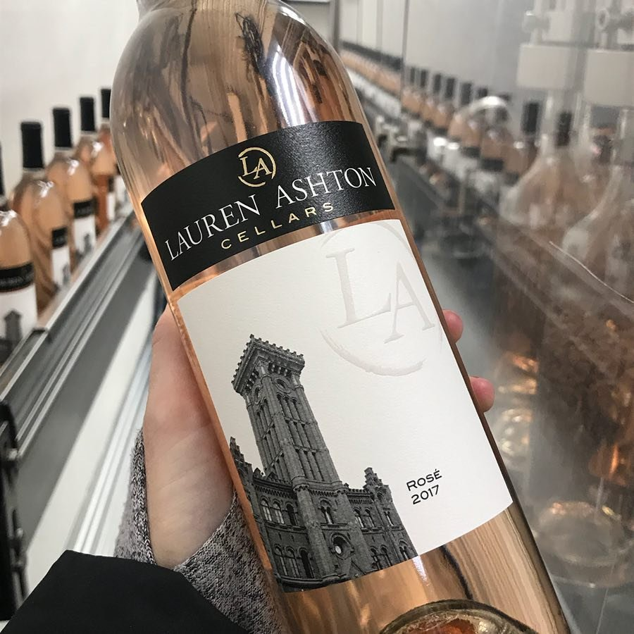 Person holding a bottle of rosé wine from Lauren Ashton Cellars near Bothell, WA.