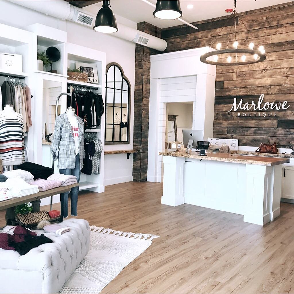 Clothing items for sale inside of Marlowe Boutique in Bothell, Washington.