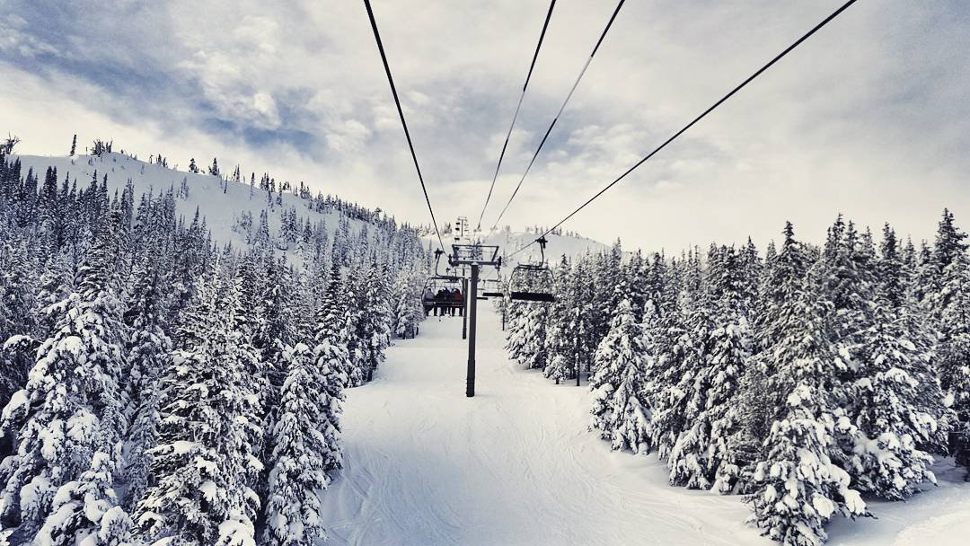 People riding the chair lift at the snowey Mission Ridge Ski Resort near Bothell.