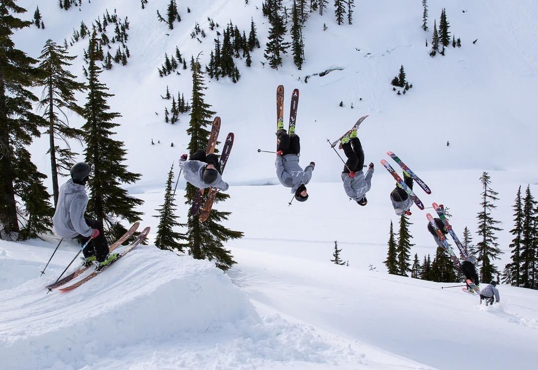 Person doing a flip on skis at Mt. Baker Ski Resort near Bothell, Washington.