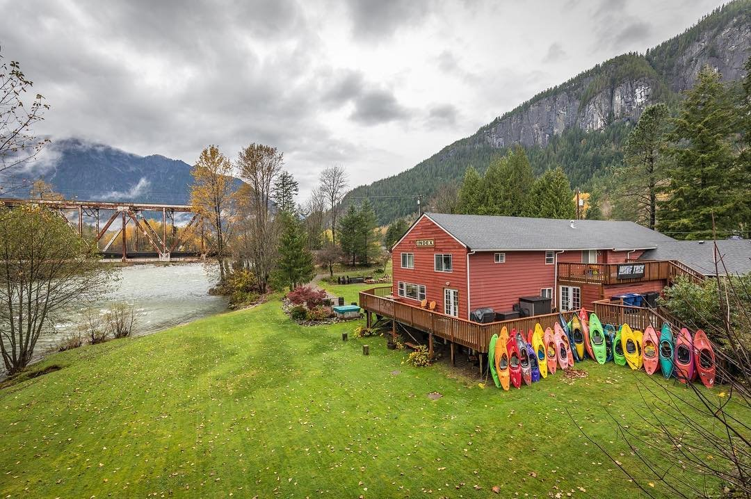 Kayaks up against the porch at Outdoor Adventure Center near Bothell, Washington.