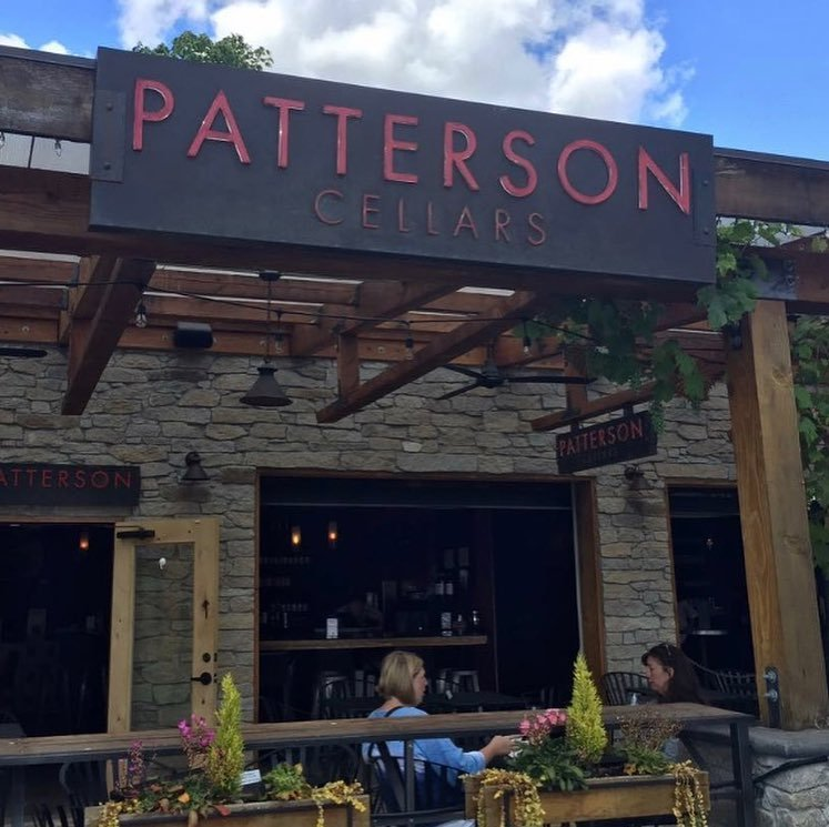 People sitting on the outdoor patio at Patterson Cellars near Bothell, Washington.