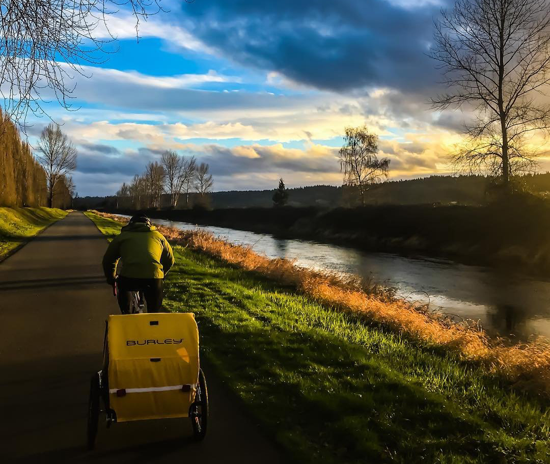 Person riding their bike down the Sammamish River Trail in Bothell, Washington.