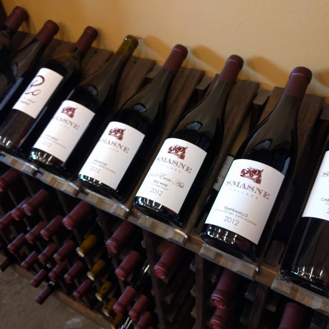Wine bottles on a display rack at Smasne Cellars near Bothell, Washington.