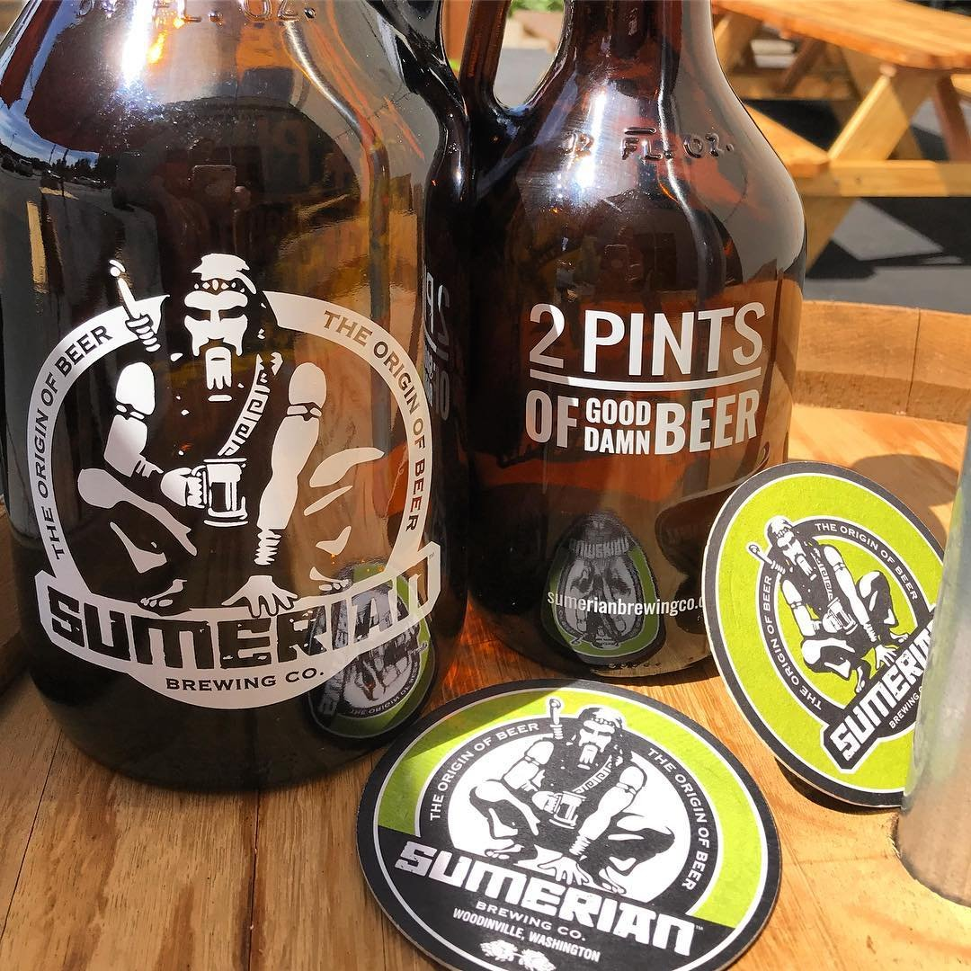 Two large growlers of beer from Sumerian Brewing Co near Bothell, Washington.