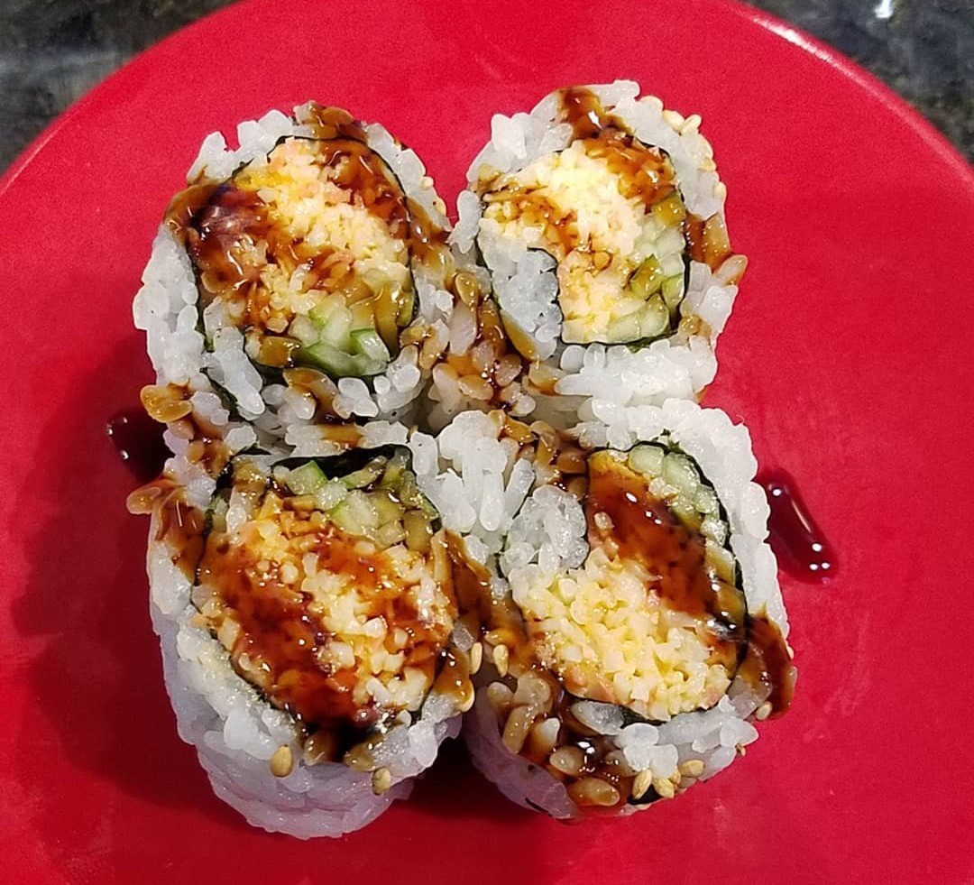Plated sushi with soy sauce from Sushi Zone Japanese restaurant in Bothell, WA.