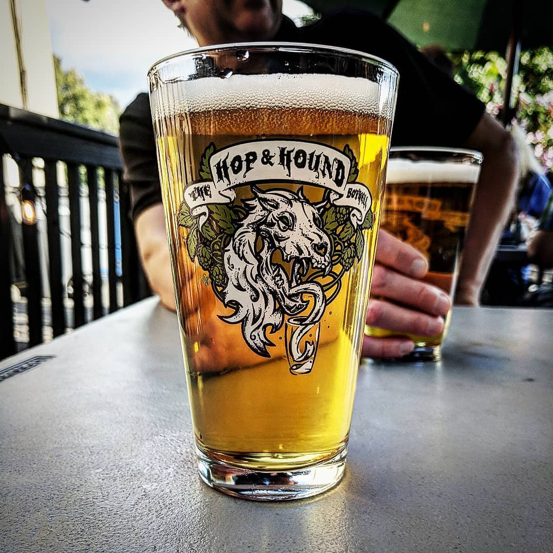 Man with full glass of beer at The Hop and Hound in Bothell, Washington.