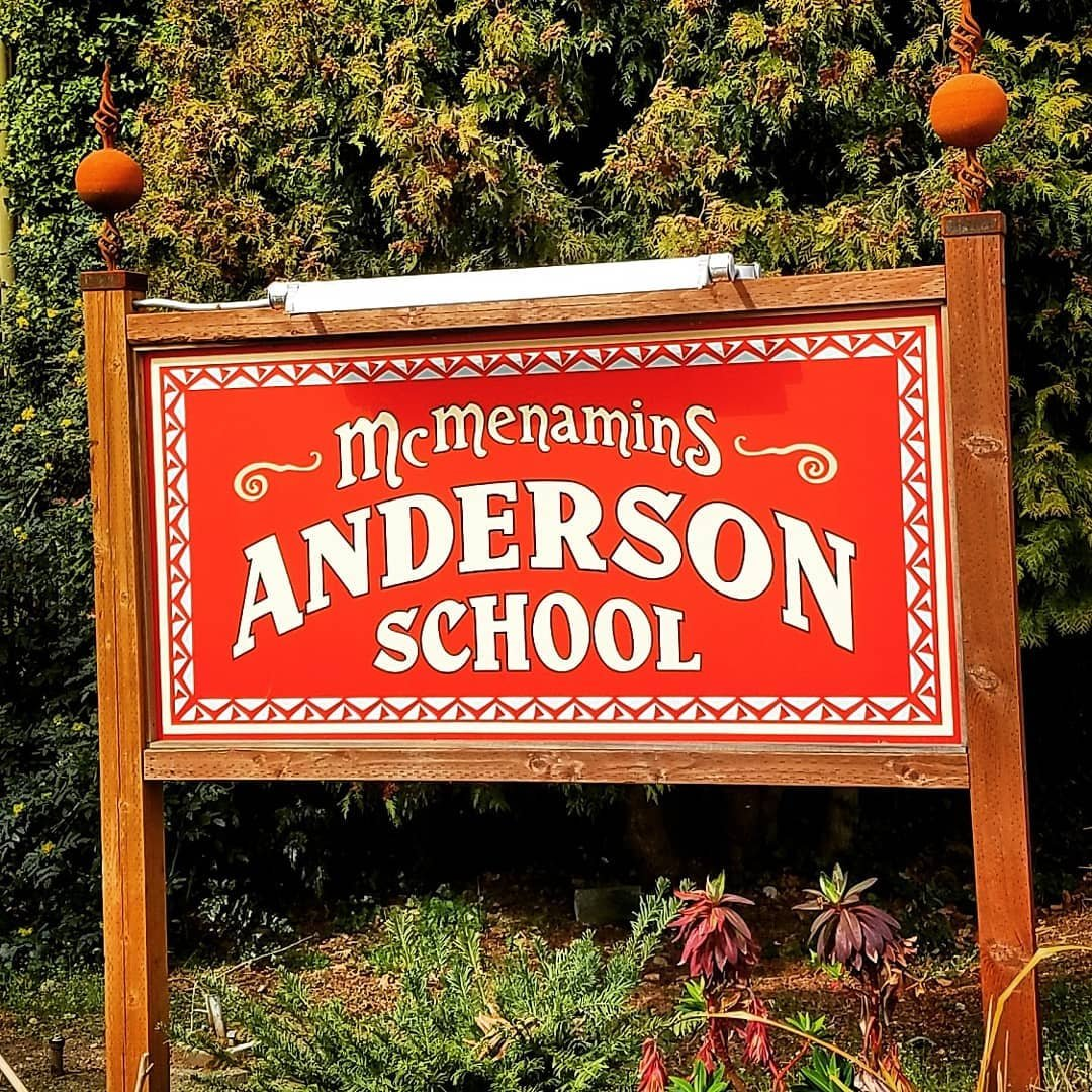 Sign outside the Market at McMenamins Anderson School in Bothell, Washington.