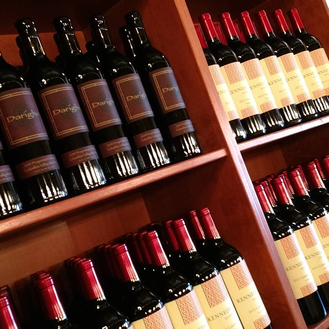 Shelves lined with bottles of wine at The Woodhouse Wine Estates near Bothell.