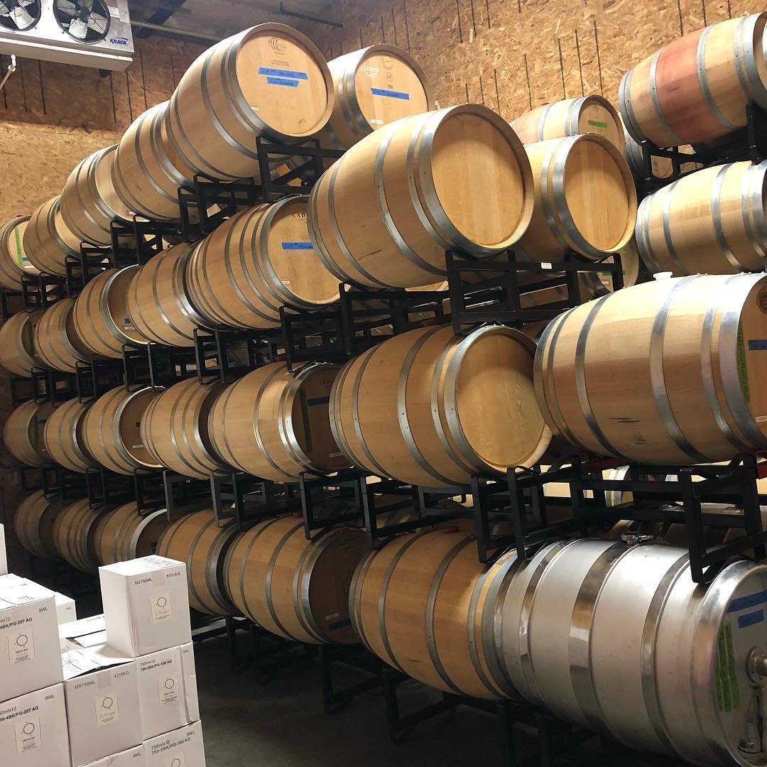 Large barrels of wine stacked up at Three of Cups Winery near Bothell, Washington.