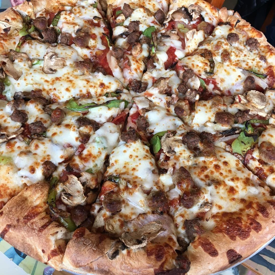 Large meat and veggie pizza from Uncle Peteza's Pizzeria in Bothell, Washington.
