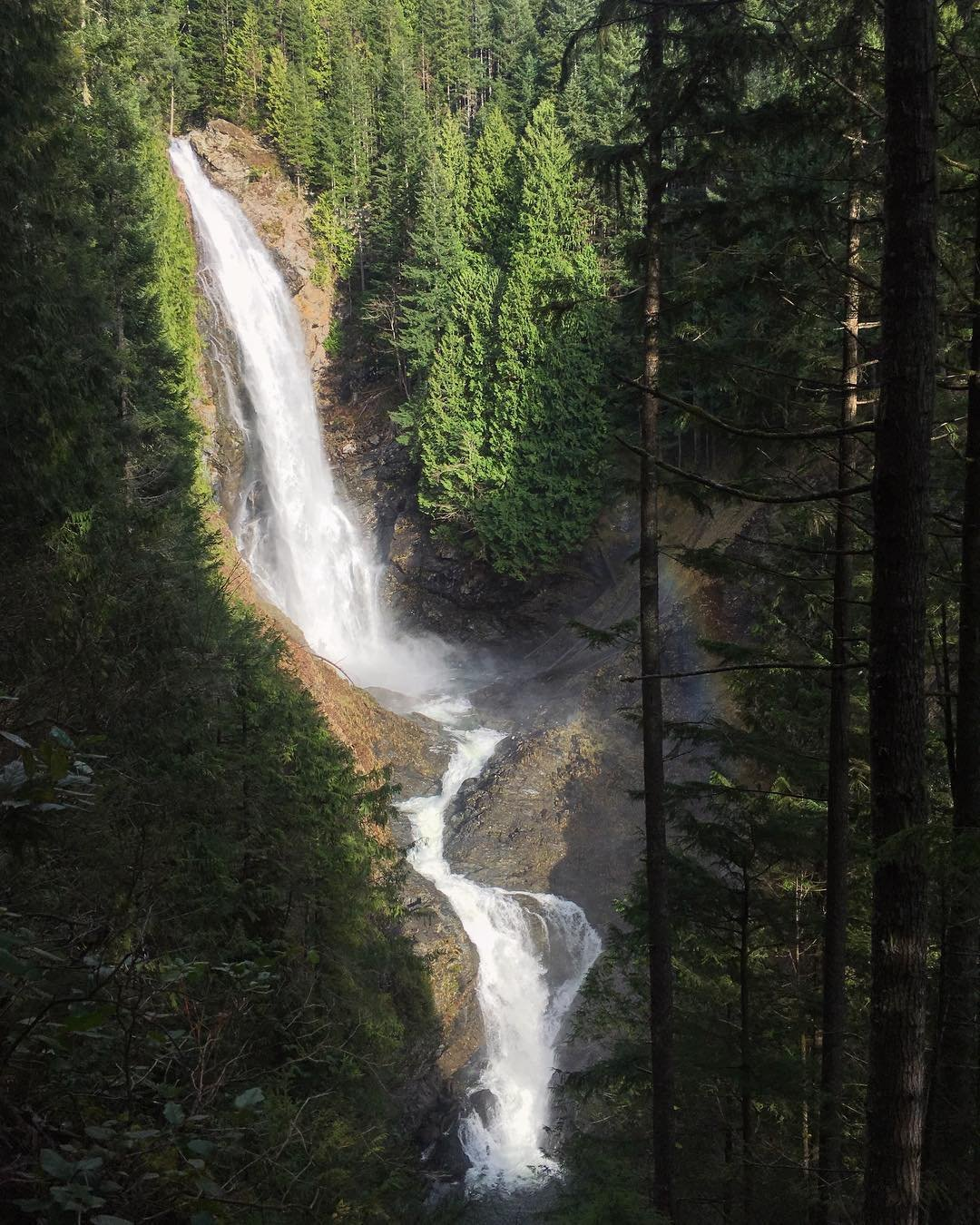 Large waterfall surrounded by trees at Wallace Falls near Bothell, Washington.