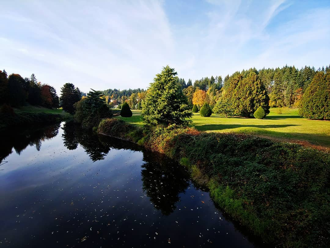 View of the golf greens and river at Wayne Golf Course in Bothell, Washington.