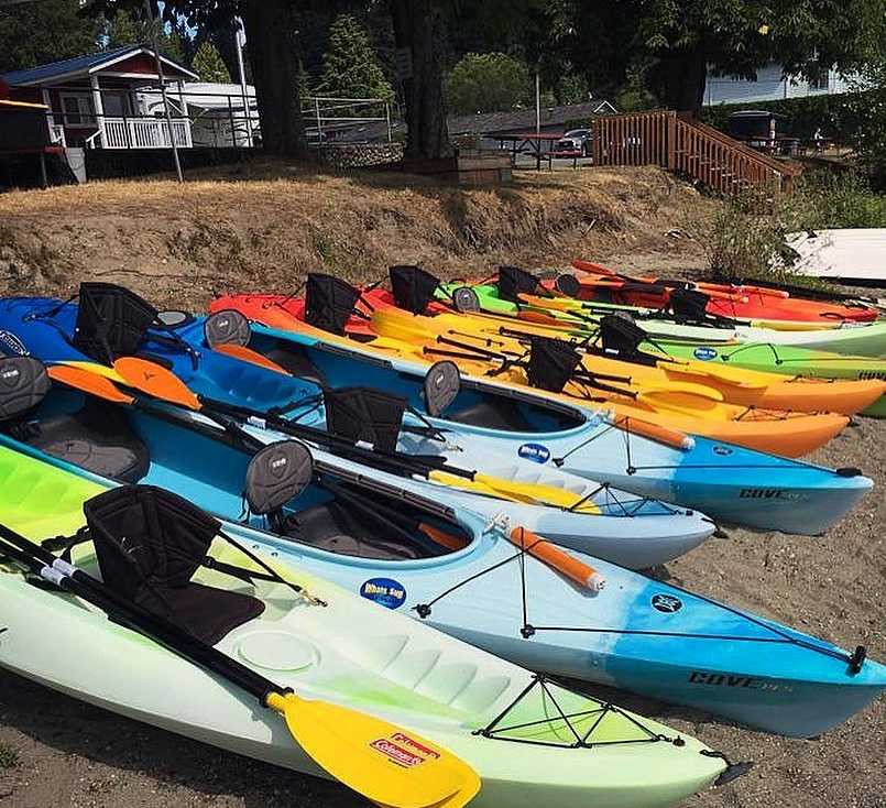 Kayaks lined up ready to go into the Sammamish River in Bothell, Washington.