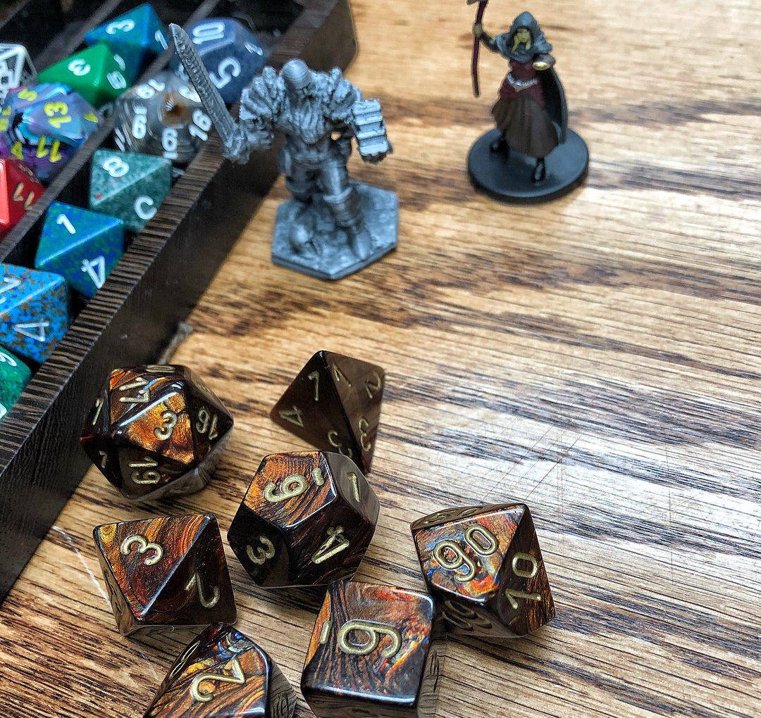 Board game dice and character pieces at Zulu's Board Game Café in Bothell.