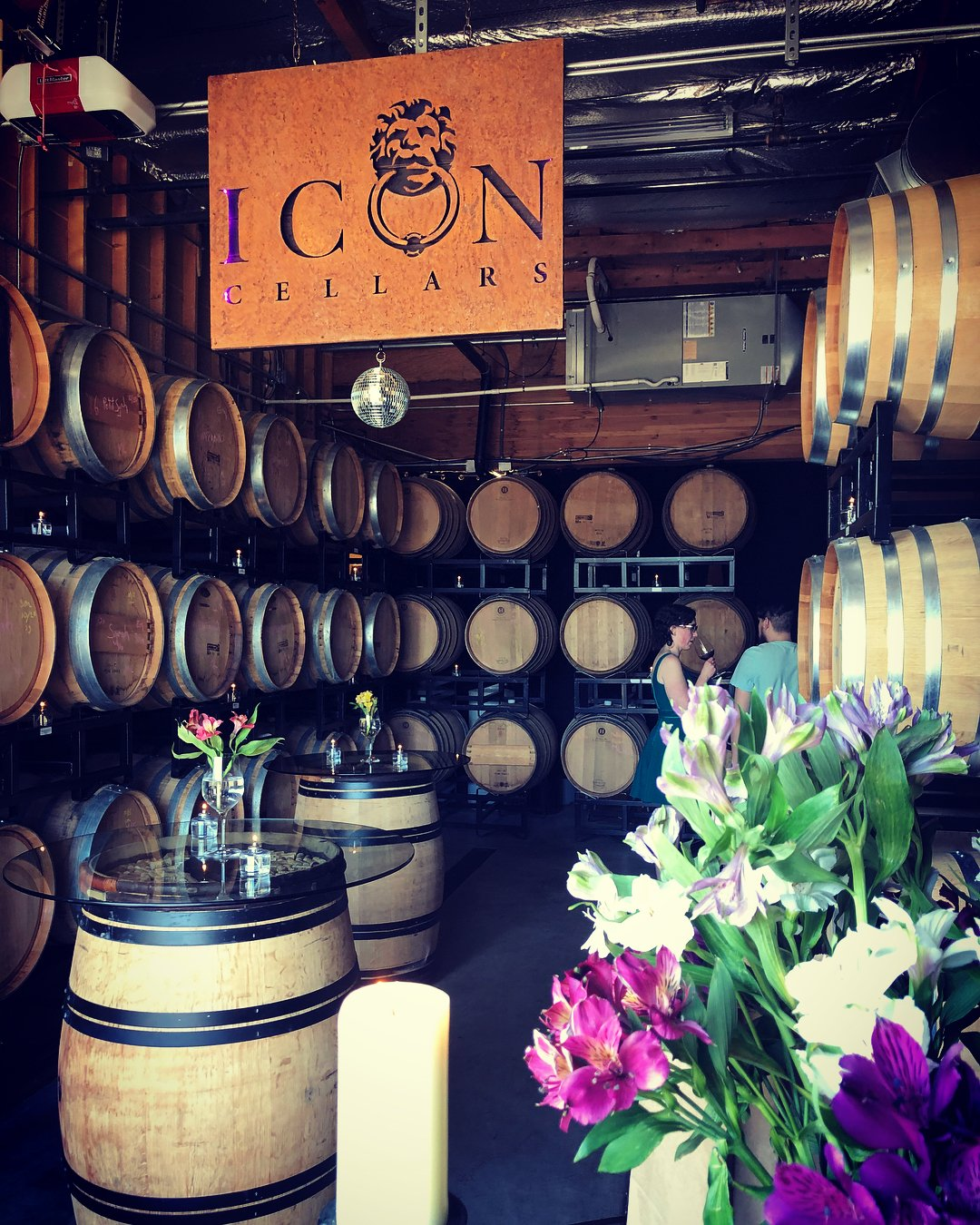 Tasting room filled with barrels of wine at Icon Cellars near Bothell, Washington.