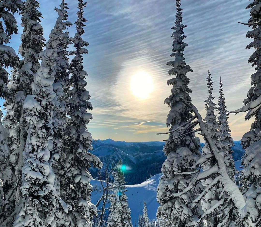 bothell-play-crystal-mountain-resort-sun-through-the-snow-covered-trees