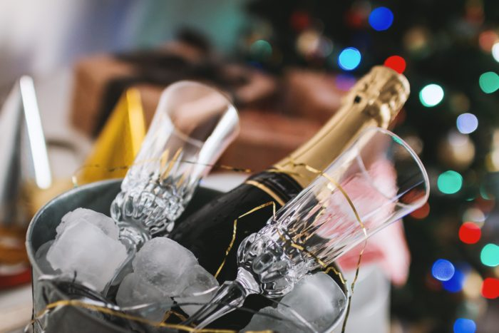 Champagne glasses and champagne in ice bucket with streamers