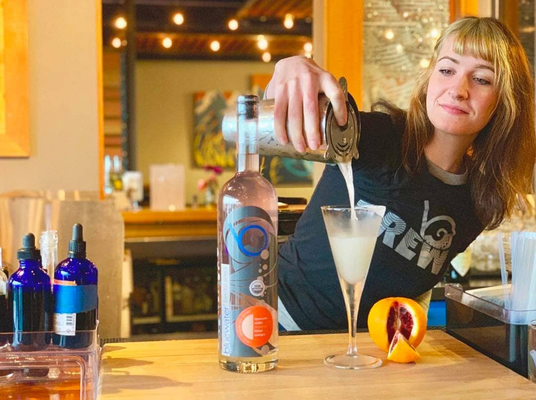 bothell_sip_bluewater-distilling-bartender-pouring-craft-cocktail